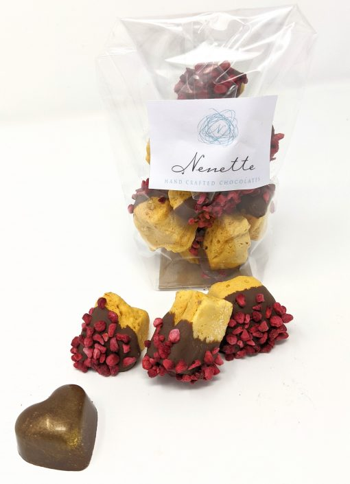 Chunks of Cinder Toffee (honeycomb) dipped in milk chocolate and sprinkled with freeze-dried raspberries